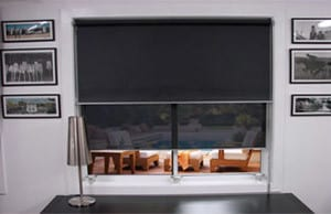 black dual roller blinds in a living room