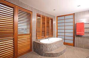 beautiful cedar shutters in a bathroom