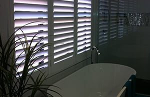 pvc shutters above a bathtub