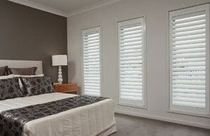 Timber shutters in a bedroom