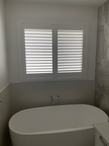 pvc shutters overlooking a bathtub