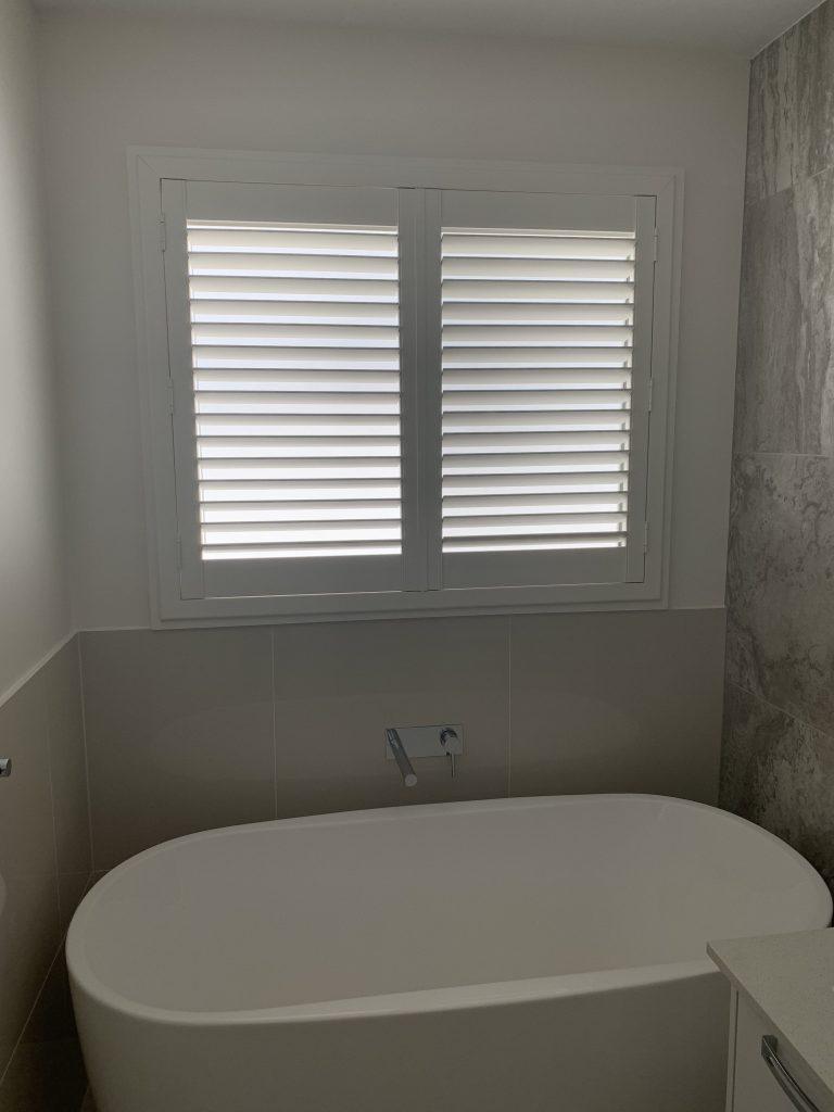 pvc shutters overlooking a bathtub