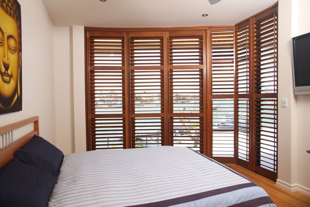 cedar shutters in a bedroom