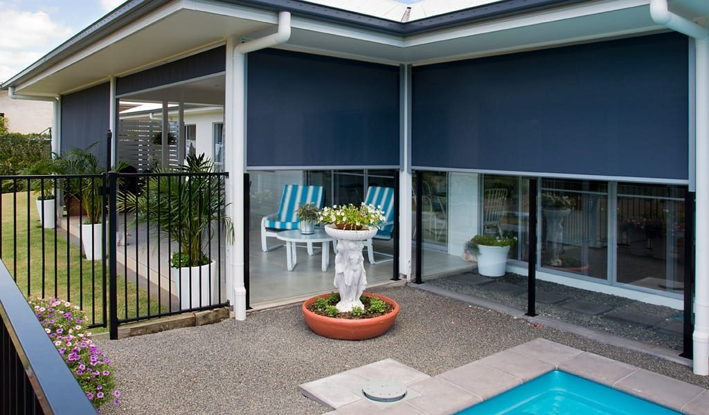outdoor awnings over a pool area