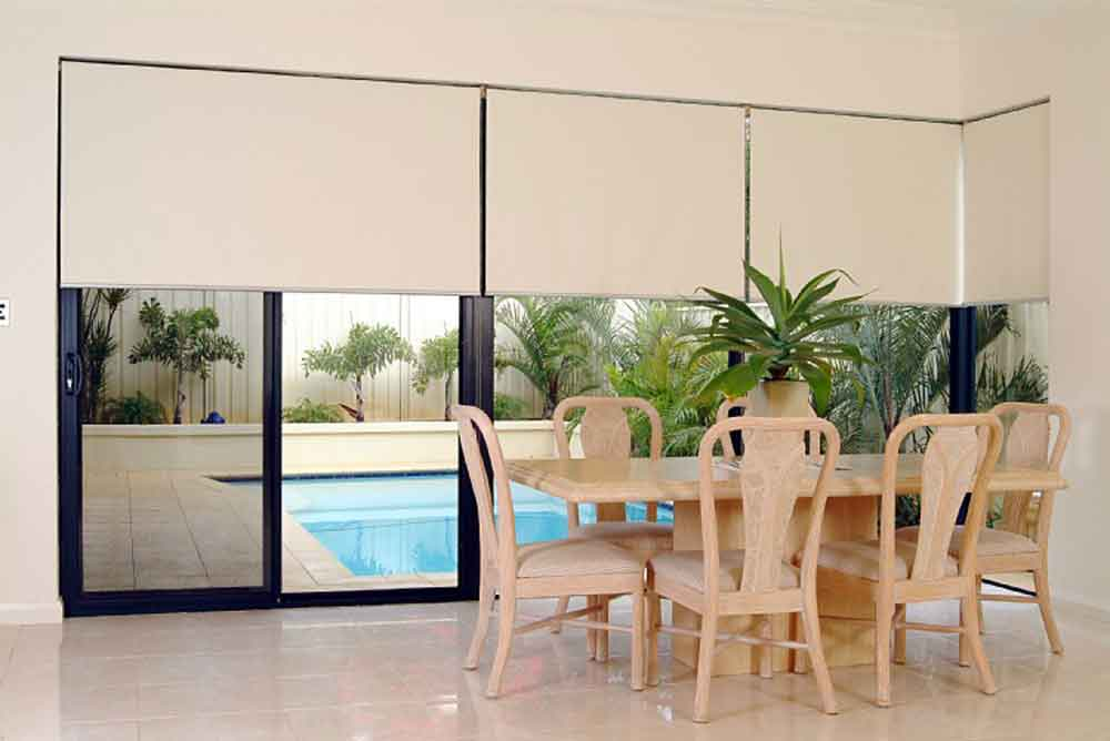 beige roller blinds in a dining room