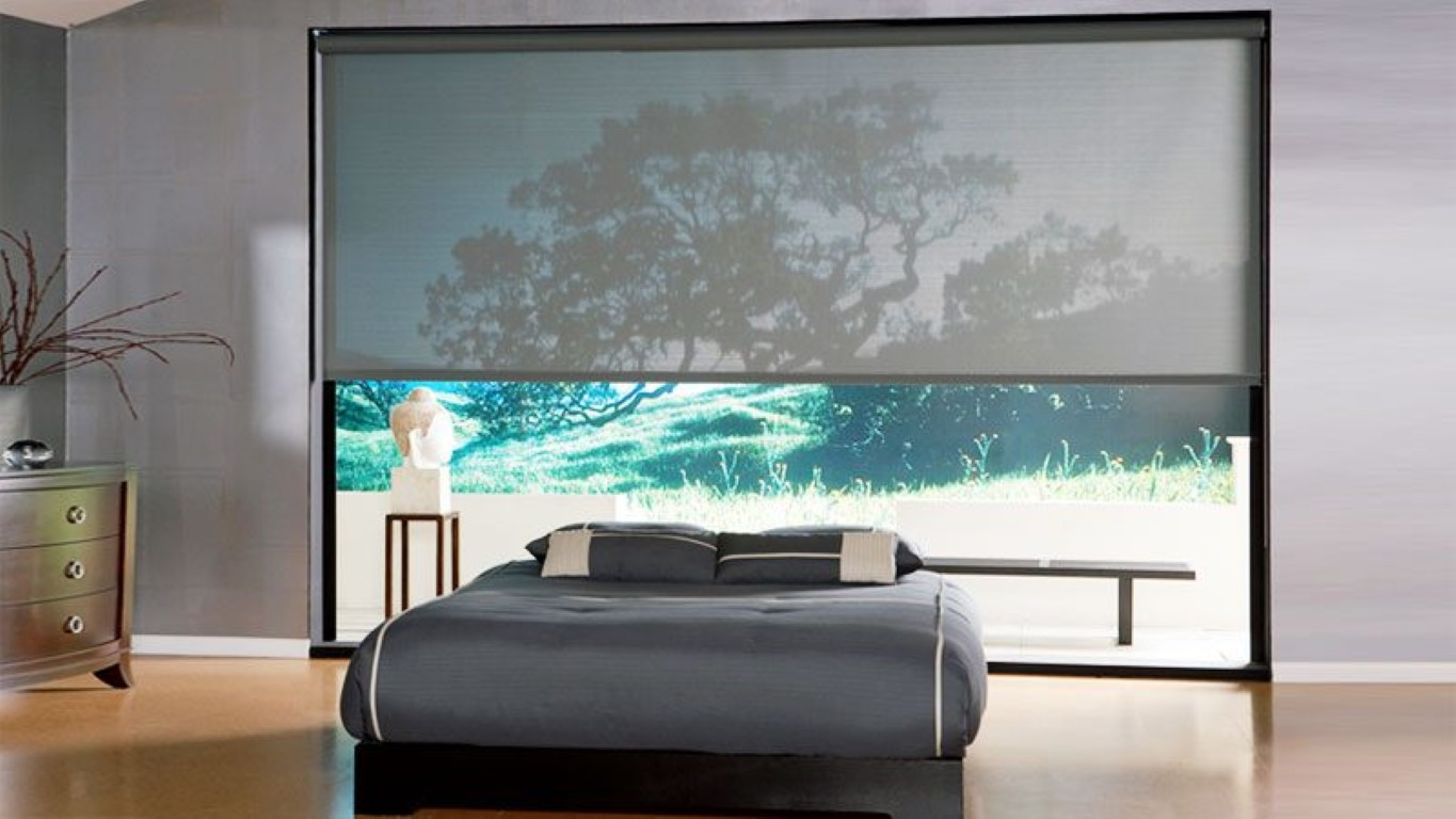 sunscreen roller blinds in a bedroom
