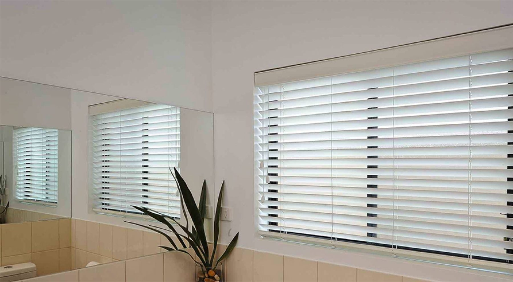 white venetian blinds in a bathroom