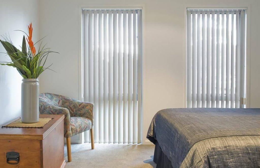 vertical blinds in a bedroom